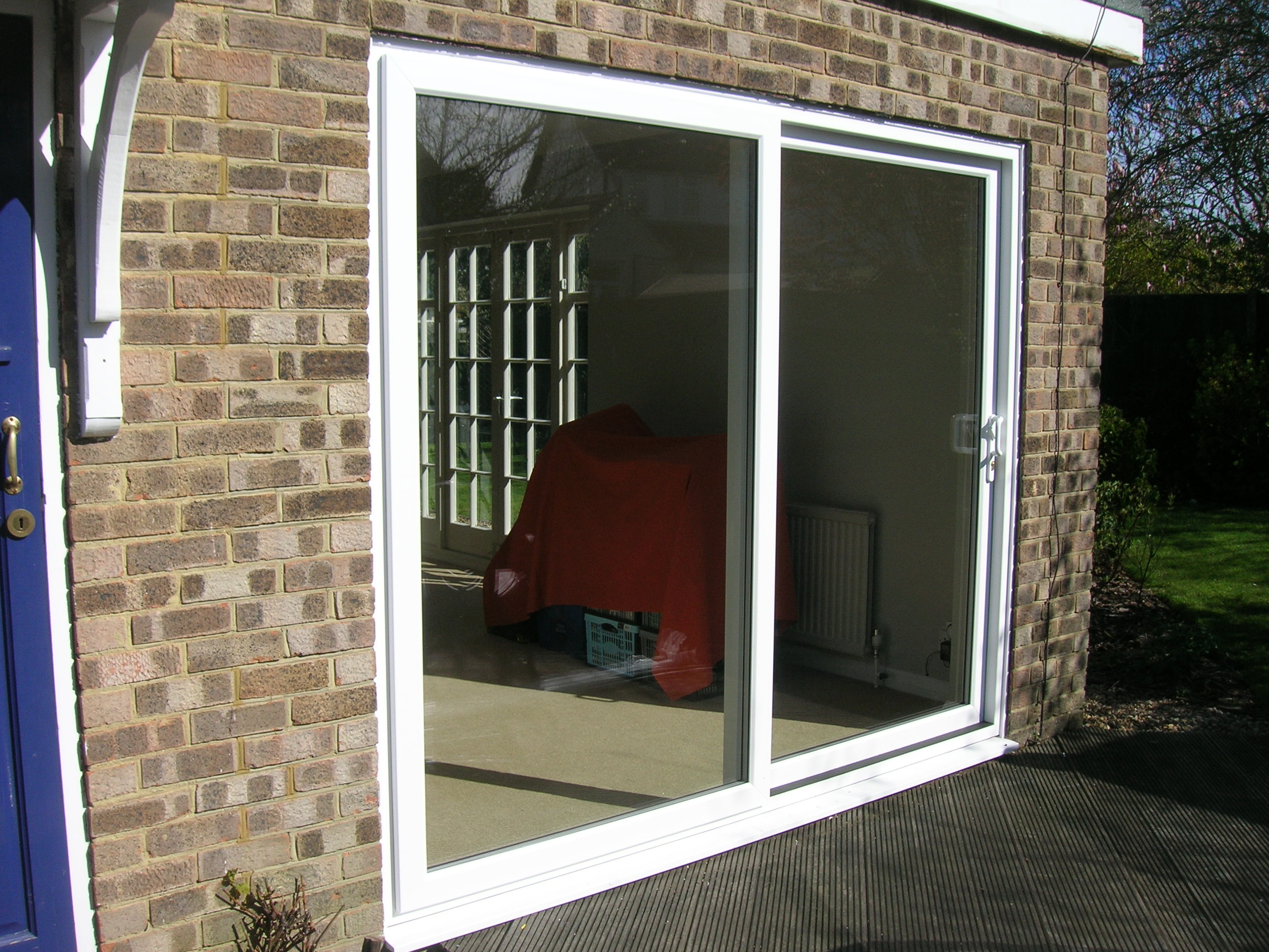 Upvc patio doors sutton sliding doors london for Upvc balcony doors